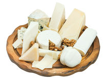 Wooden plate with various cheeses Stock Photos