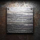 Wooden plate on wall Stock Photos