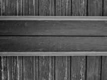 Wooden plates on aged shabby wall, black and white royalty free stock image