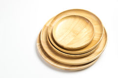 Wooden plates or trays isolated white background. Wooden plates or trays isolated on white background Stock Images