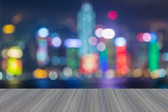 Wooden platform with abstract blurred bokeh Hong Kong city lights skylin stock photo
