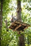 Wooden platform in adventure playground path Stock Photos