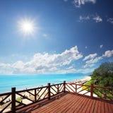 Wooden platform beside beach Royalty Free Stock Photo