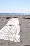 Wooden platform on the beach. Boardwalk towards on the beach Royalty Free Stock Photo