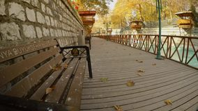 Wooden platform and a bench next to a canal in the ancient city of Konya. KONYA / TURKEY - 11.20.2016 central streets of the ancient Turkish city stock footage