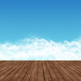 Wooden platform and a blue sky with clouds. Royalty Free Stock Images