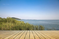 Wooden platform beside the lake Stock Photo
