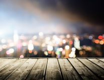 Wooden platform and lights of night Stock Image