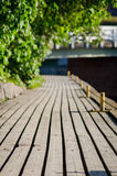 Wooden platform molo. Wooden platform sunny molo background Stock Image