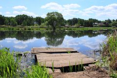 Wooden platform. Old wooden platform on the small river stock photos