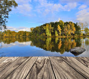 Wooden platform over the autumn lake Stock Photography
