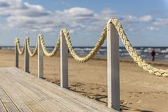 Wooden platform with ropes on the seashore, cloudy weather, the Baltic coast, Jurmala stock image