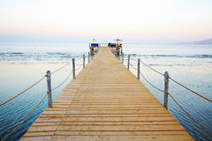 Wooden platform beside sea Stock Images