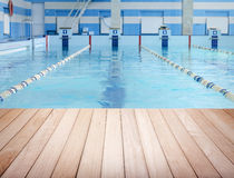 Wooden platform and swimming pool Royalty Free Stock Images