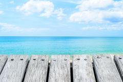Wooden platform beside tropical beach and blue sky Royalty Free Stock Photography