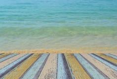 Wooden platform beside tropical beach , sea water Stock Photo