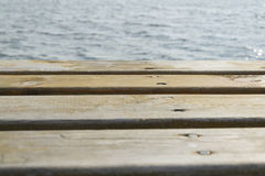 Wooden platform and water Royalty Free Stock Photo