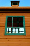 Wooden Play House with Green Windows Stock Photography