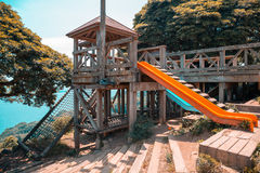 Wooden playground equipment with blue ocean in Japan Royalty Free Stock Photo