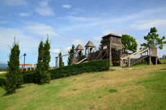 Wooden playground for kids on hill Stock Photos