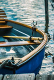 Wooden pleasure rowboat at the pier of a lake Stock Photos