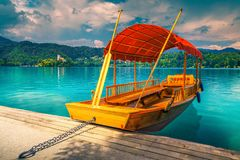 Wooden Pletna Boat On The Lake Bled With Small Island Stock Photo