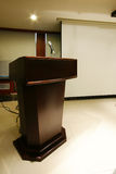 Wooden Podium with Microphone Stock Photo