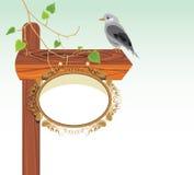 Wooden pointer with bird Stock Photos