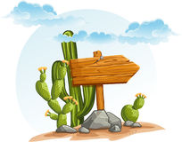 Wooden pointer with cacti in the desert Stock Images