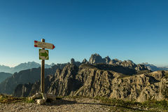 Wooden pointer for hikers in the Dolomites. stock images