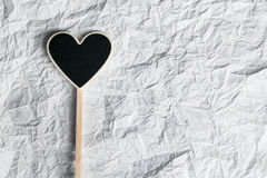 Wooden pointer in the shape of a heart Stock Photo