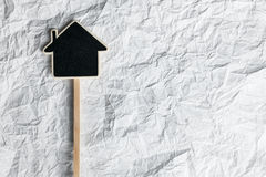 Wooden pointer in the shape of a house Royalty Free Stock Image