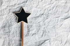 Wooden pointer in the shape of a star Royalty Free Stock Photography