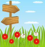 Wooden pointer to the green lawn Stock Images