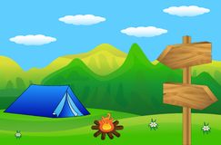 Wooden pointer and tourist tent to the green lawn Stock Photo