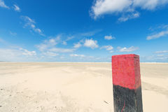 Wooden pole at the beach Stock Image