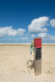 Wooden pole at the beach Stock Photography