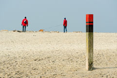 Wooden pole beach Texel Stock Photography
