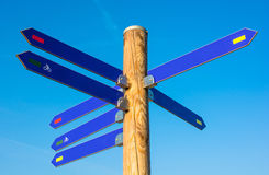 Wooden pole with direction arrows Royalty Free Stock Photo