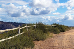 Wooden Pole Fence Against Cloudy Sky in South Africa Stock Image