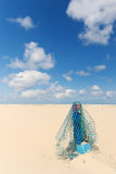 Wooden pole with fishing net at the beach Stock Photos