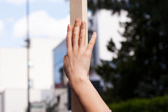Wooden pole held by hand Royalty Free Stock Images