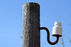 Wooden pole with an insulator Stock Photos