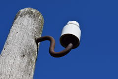 Wooden pole with an insulator Royalty Free Stock Images