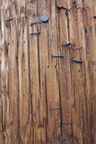 Wooden pole with staples background Stock Photography