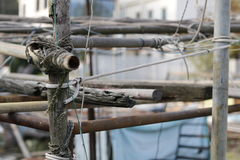 Wooden pole structure. Fishing village, tai o, Hong Kong. Homemade structure with rope, sticks and metal poles Stock Image
