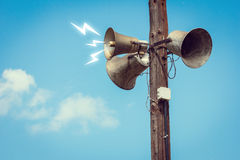 Wooden pole with three speakers Royalty Free Stock Photography