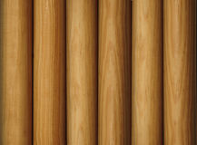 Wooden poles as a background Stock Images