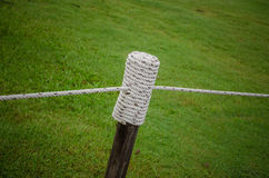 Wooden poles covered with rope Royalty Free Stock Photos