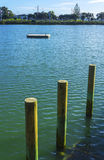 Wooden Poles. At Judges Bay Parnell Auckland New Zealand Royalty Free Stock Photo